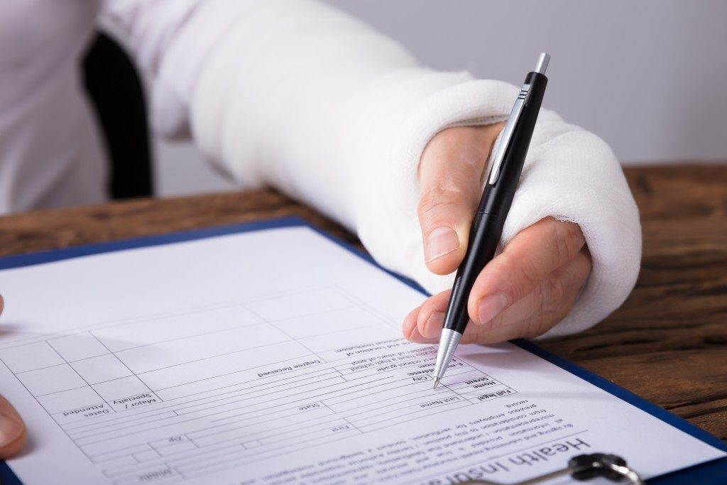 injured person signing a document