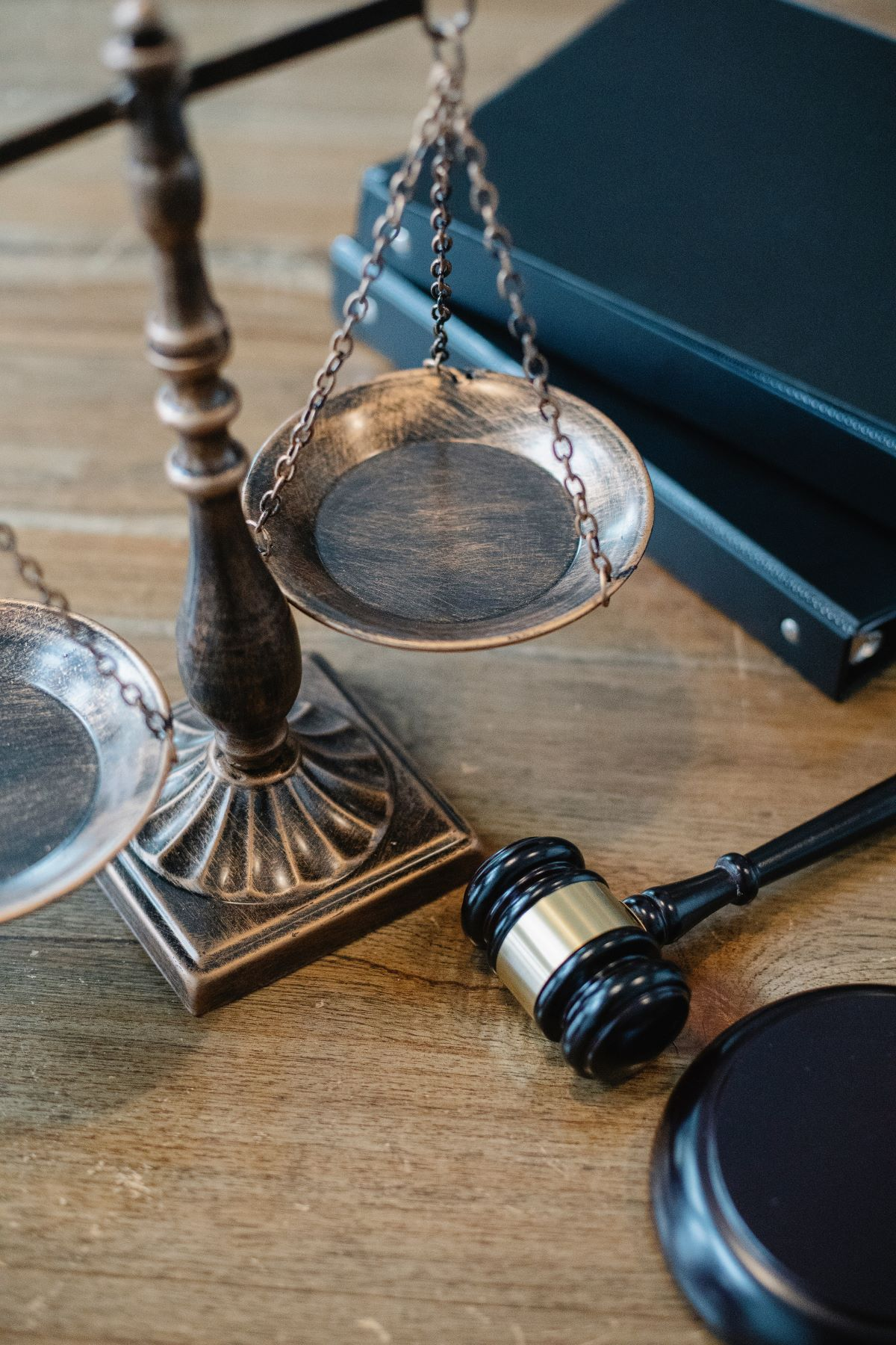 gavel on desk with scales of justice
