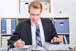 man computing taxes